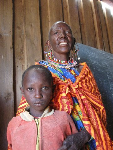 Maasai now approach a challenging precipice: between Tradition and Modernity.  Here, a grandmother with no formal schooling visits her granddaughter's classroom at one of the first schools built in the area.
