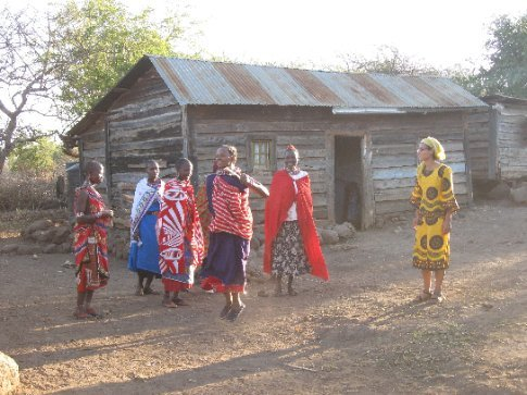 Maasai women joyfully teach Mi a traditional dance with