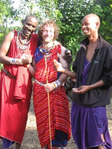 Which of these guys is not true Maasai??  Sankale and Mayani bid farewell to a traditionally dressed Ive.