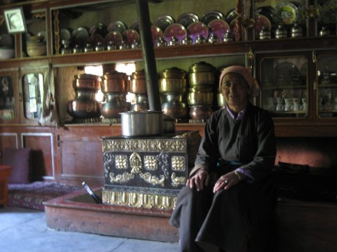 My Ama-le in front of her stove and the display of the family's pots going back generations -- the marks of the traditional Ladakhi kitchen