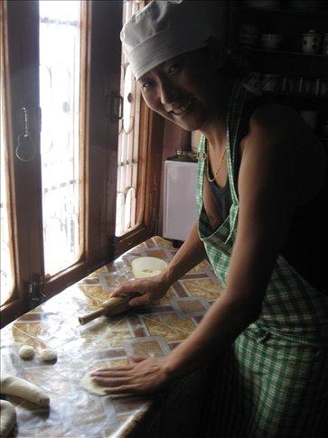 In Mcleod Ganj, Lhamo instructs us to make steamed momos -- Tibetan dumplings
