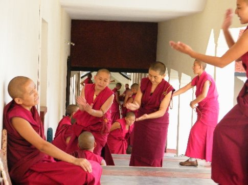 Nuns at Dolma Ling nunnery in Dharamsala debate the finer points of the nature of reality using the traditional