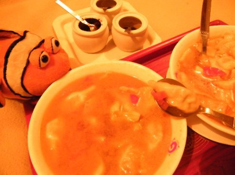 Tangelo dines on delicious traditional Tibetan soups -- a bowl of Mothuk (momos, or dumplings, in broth) and a bowl of Thenthunk (handmade pasta in broth).