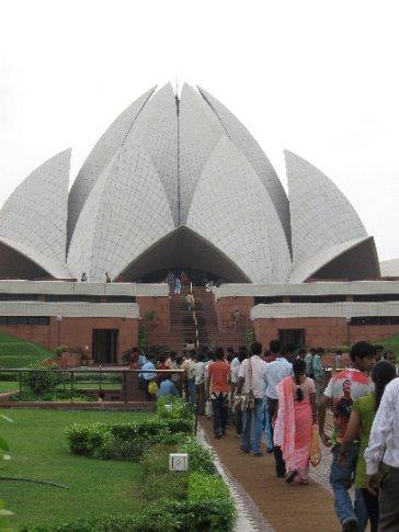 Pilgrims of all faiths make their way into the B'hai Lotus Temple in Delhi.