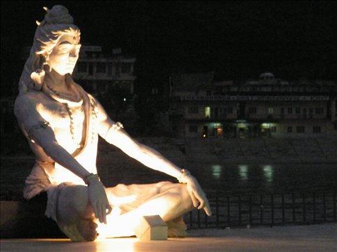 Hindu deity, Shiva, holds court over the aarti on the Ganges in Rishikesh