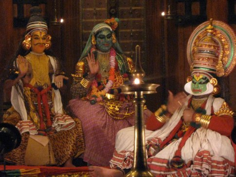 In addition to the wild make-up, Kathakali is also known for its elaborate costumes, detailed gestures and well-defined body movements presented in tune with music and percussion. Here Lord Shiva and his wife, Parvati, hold court over the newly egoless Arjuna.