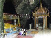 We rented bikes and made the 13km ride from Battambang to an outcrop-turned-temple complex of Phnom Sampeau. Certainly the most disturbing part of the visit was touring this cave-shrine that exhibits a long, golden reclining Buddha next to a skull-and-bone filled memorial. This cave is known as the Killing Cave, where the Khmer Rouge murdered innocent victims and dumped their bodies through a natural skylight into the cave below. These two kind elders are the cave's caretakers.: by ivan_miral, Views[207]