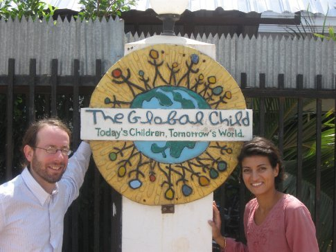 Us in front of the school sign!