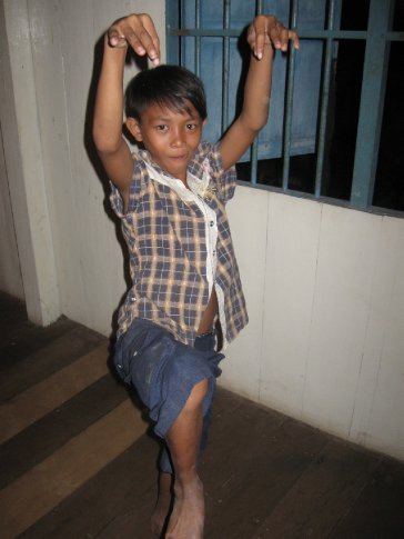We joined in running a Saturday night program at one of the local cafes for kids from several of the local NGO programs in Siem Reap.  Here, a TGC kid strikes a Karate Kid pose during a statue game.....all the kids had so much energy and were so much fun!