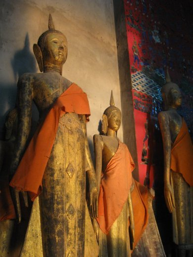 And Luang Prabang's wats are filled with treasures, as well -- like these Standing Buddhas.