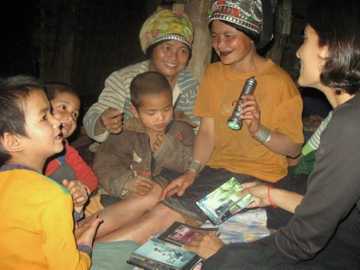 Mi shows some Akha woman photos of our family and friends.