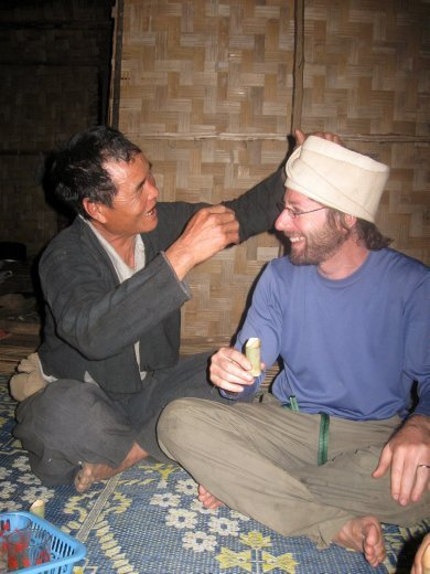 In the midst of sharing some after-dinner Laos Laos (local moonshine), Ive is adorned with a traditional Akha hat.