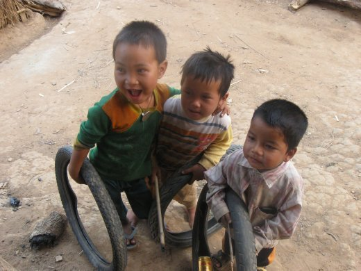 The village children play with great enthusiasm and joy -- whether its good ol' tire rolling, a source of fun for kids all over the world...