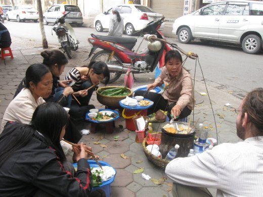 Ive also jumped right in, sitting down at a traditional sidewalk food stall serving up fried tofu, rice noodles, fish sauce, chillies, and fresh herbs.