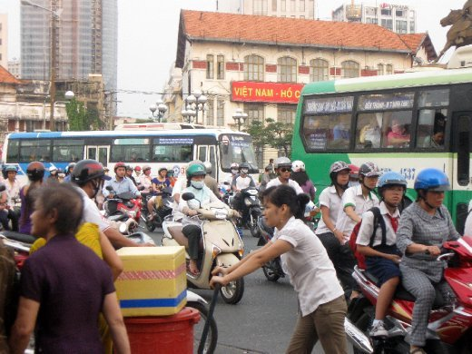 ...right into Saigon traffic! (Renamed Ho Chi Minh City after North Vietnam took the South at the end of the War in '75, it's still Saigon to most). Forget the helmets, Mi wished we'd had hockey goalie gear when riding on the back of motorbike taxis!