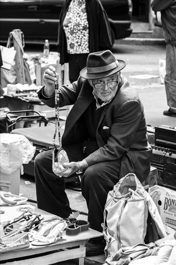 Every day old man comes to street to sell things that he does not need any more