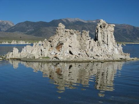 Water in Mono Lake has higher salt content then sea water. Stalagmites grow from bicarbonate also present at high levels.