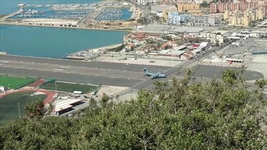Plane landing on the runway that crosses the road into Gibraltar...really.