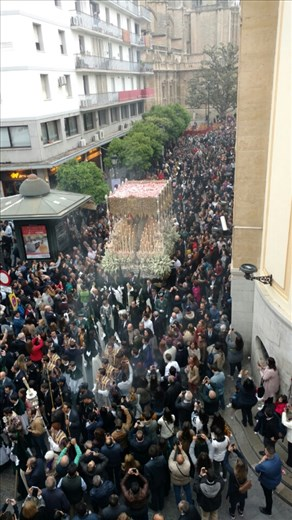 The Virgin of Esperanza de Triana, with huge crowds at 7:30am. Note the rose petals thrown down on her