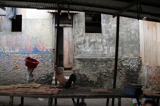 Walking through the Belen market to get to my hostel, a man rests at his stall.