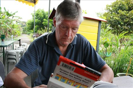Mr Stafford in a local restaurant in Krangi studying a map of what to eat ?!?