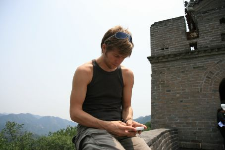 James emailing from the top of the wall