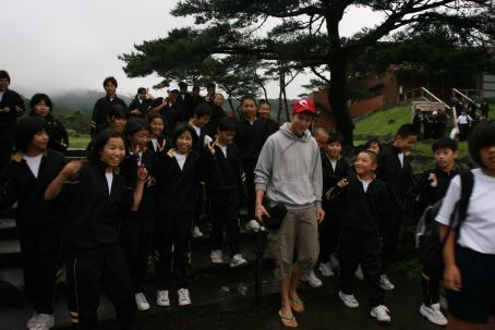 James being harrassed by Japanese school kids desperate to speak English to us! Cute!