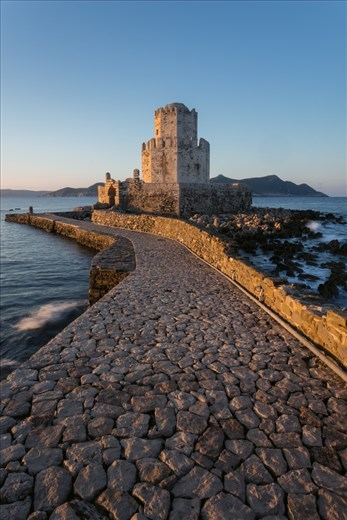 This is the bourtzi at the end of the castle in Methoni. It had been used as many things including a prison at one point.  The castle is never usually open within the golden hours, but a fortunate passing at sunrise saw the gates open allowing me to capture this image,