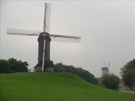 There are massive windmills everywhere. Can you see me standing next to it.