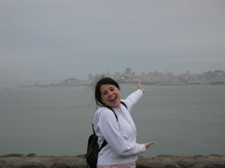 Jenn with the city behind