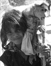 Serious(girl) complementing the carefree(monkey). Hampi, India.: by jathin, Views[80]