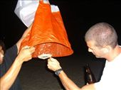 Lighting a good luck lantern on the beach: by jciecko, Views[223]