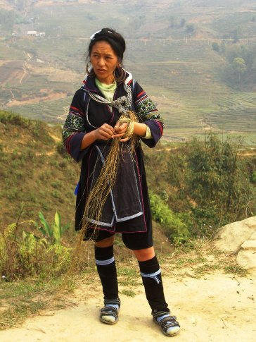 Black H'mong woman working hemp