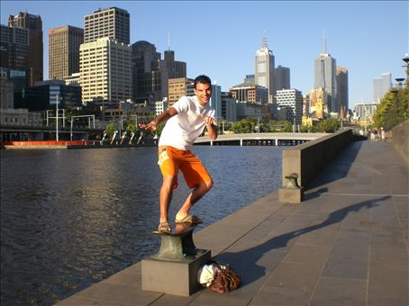 Jeremie surfing on the Yarra River, Central Melbourne