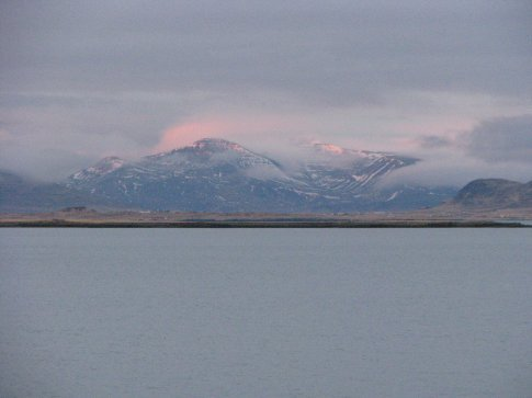 the view from reykjavik, a city on a bay with these beautiful mountains on the other side