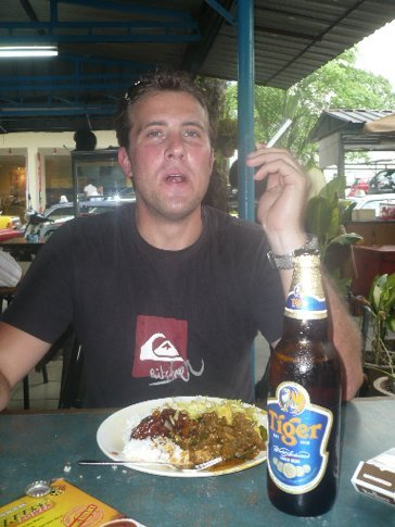 Cheap grub from a dodgy market with beer and a smoke to wash it down