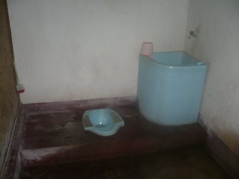 My bungalows toilet. One of the traditional mandis, complete with a bucket of water to wipe your arse. Yes I did my first crap in it on the second day.