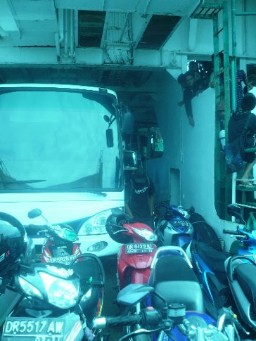 Bikes and cars loaded up on the ferry to Sumbawa