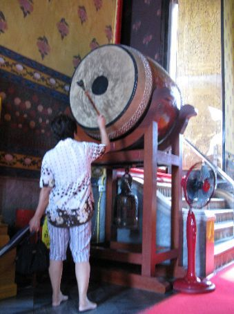 Banging the drums in the temple (Baipoon showed me how to do it), but not me in the photo.