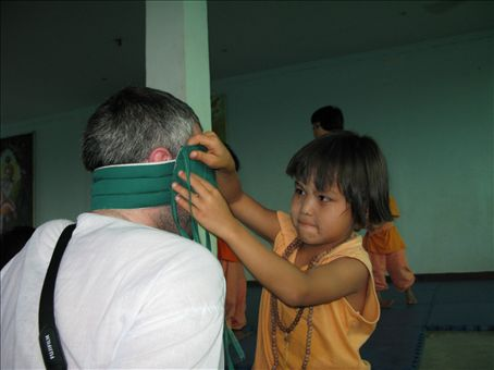 Orphan successfully blindfolding Martin.
