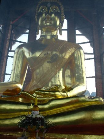 The buddha in the temple at the top of the hill.