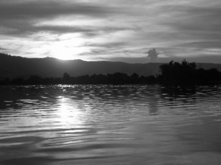 The sun setting on the lake as we head back to Kampot by boat.