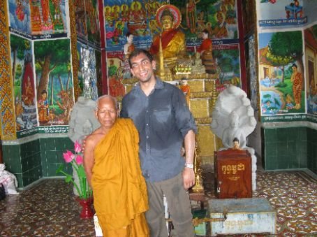 I climbed to the temple at the top of the mountain where the killing caves are located with a frenchman who I met along the way. The climb was sweaty business, as you can see from the photo, but we met this eccentric business-minded monk there.