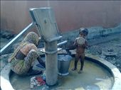 Mother and child at hand pump at a village, Indoore, India.: by jha, Views[631]