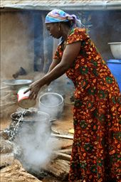 Woman cooking in a traditional village in Ghana. : by jihyunpark, Views[418]
