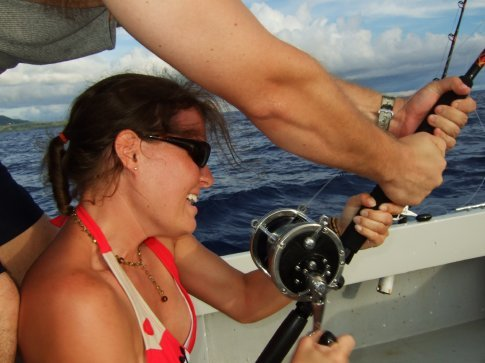 Trying to reel in the mahi mahi with a little help from Danny...the line snapped a few minutes later.