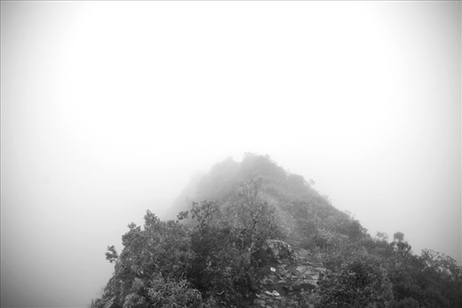 While hiking up to the summit of Machu Picchu mountain, on a day with ill-tempered weather, one can lose track of the view and get lost in the smoky chill of the clouds.  Soaring heights are diminished to just a few feet and temperatures plummet as the sun is blocked from the skin.  Heart rates can rise, not just because of the elevation, but because of the isolation, displacing time for an otherworldly moment.