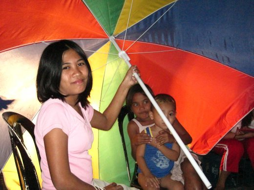 Local kids holding the umbrella the car lights were shinning in our eyes!!!