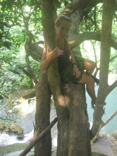 Jo on the overhanging tree high above the waterfalls