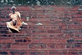 An ascetic man rests on steps lining the river Ganges. Such men live a life of severe self-discipline and abstention from all forms of indulgence.: by joecyriac, Views[169]